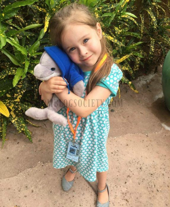 emma holding her dolphin-mbs